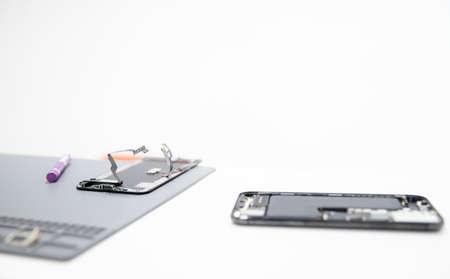 Workplace foreman service for repairing mobile phones, tools screwdriver, pliers mat 写真素材