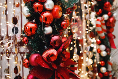 Christmas and New Year holidays bokeh light background with red apple and pine cone