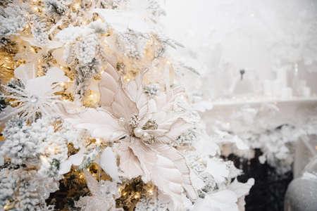 Christmas light background, macro photo of details on white tree, blurred bokeh