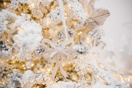 Christmas light background, macro photo snowflake with glass crystal details on white tree, blurred bokeh 写真素材