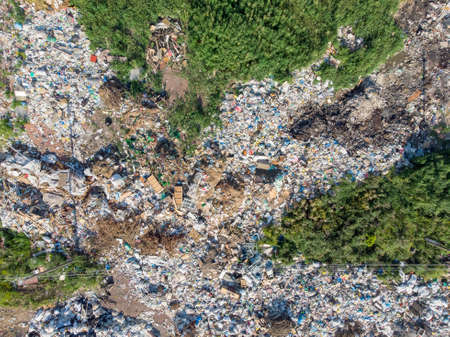 Land contamination with plastic bottles and bags. Open storage of solid waste garbage. Aerial top view 版權商用圖片