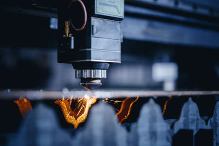 Laser CNC cut of metal with light spark