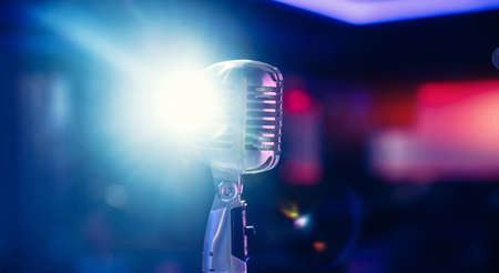 Close-up Retro vintage microphone on blurred multicolored background