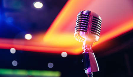 Close-up retro vintage microphone on blurred stand up background, concert in nightclub 写真素材