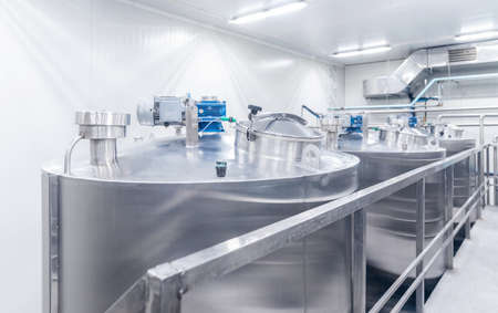 Equipment dairy plant, milk factory industry. Stainless steel storage and processing tanks 写真素材