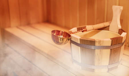 Finnish wooden Sauna small private room with traditional accessories 版權商用圖片
