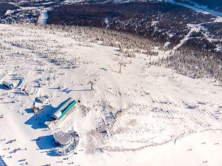 Sheregesh ski lift resort in winter, landscape on mountain and hotels, aerial top view Kemerovo region Russia 版權商用圖片