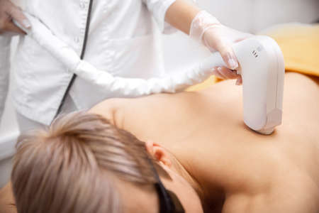 Banner hair removal cosmetology procedure from men back laser epilation studio
