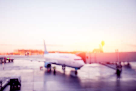 Abstract Blur background of airplane airport against sun light waiting for passengers