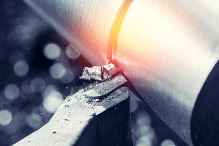 Process CNC lathe machine cutting metal. Modern industrial iron automotive technology.