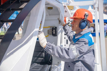 Miner engineer prepares to descend into ground on rail locomotive to mining