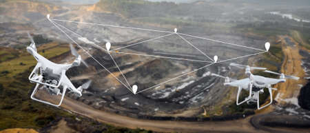 Innovation aerial uav drone copter flying with camera above opencast mining open coal. Concept engineering geology industry