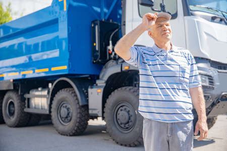 Portrait of driver truck man standing background lorry. Concept professional industrial worker trailer logistic 版權商用圖片