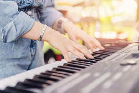 Closeup of thumbs up street musician woman playing on mobile piano