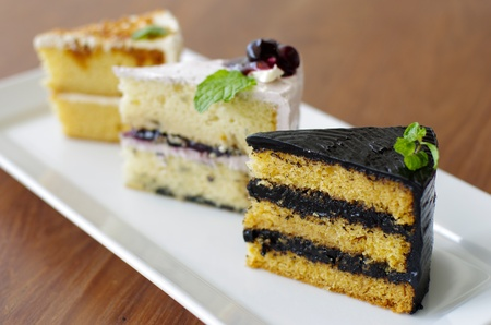 3 Piece of Sweet Cake on Wood Table