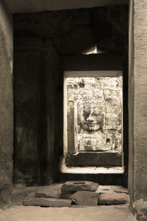 angor: Arch Way Seeing Buddha in Low Relief at Bayon Castle inside, Angor Cambodia Stock Photo