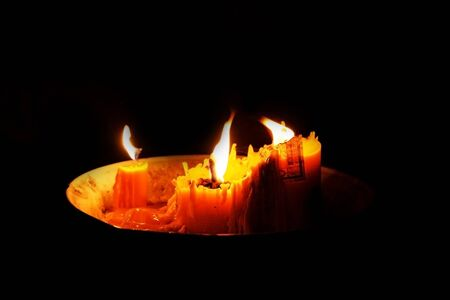 Candlelight bright Under the dark