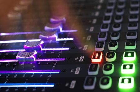 Close Up of Sound Mixer with Working Hand Point to Solo Button