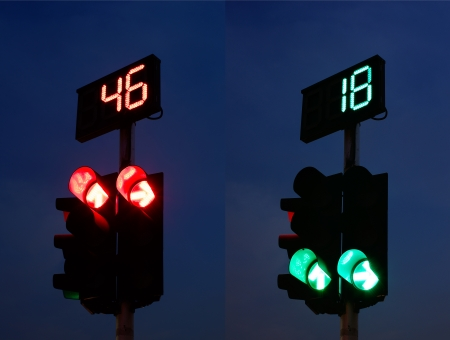Silhouette Figure of Traffic Light Pole and Countdown Sign photo