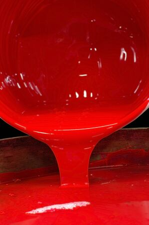 printshop: Pour of Red Color Printing Ink