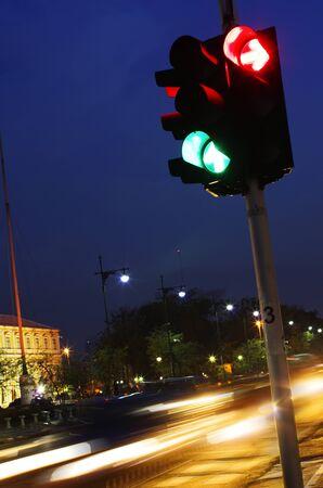traffic signal: Traffic Light in Night City with Speed Light Stock Photo
