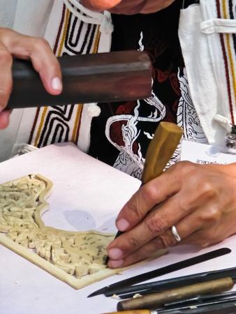 thai motifs: Woodcarving by Thai Carpenter Stock Photo