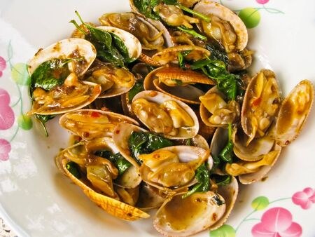 fried Clams Shell with basil leaf Stock Photo