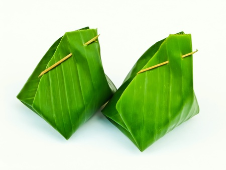 two banana leaf packages of Thai dessert