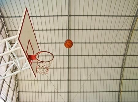 a ball going to basketball hoop photo