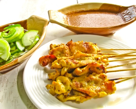 Satay ,grilled tumeric pork with sauce and cucumber salad Stock Photo - 10226782