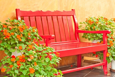 red color armchair in the garden photo