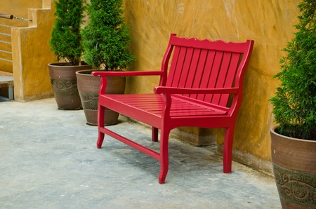 red old style wood seat at balcony Stock Photo