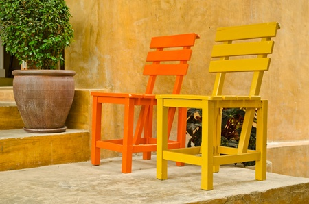 two color wood chair in garden Stock Photo