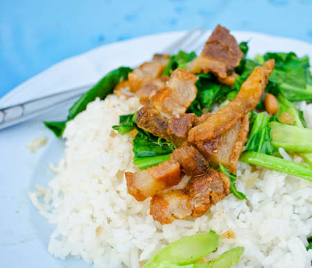 fried Chinese Broccoli with Crispy Pork on rice  Stock Photo