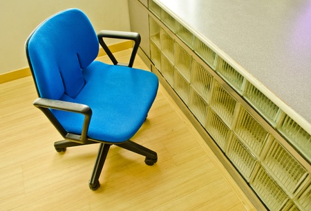 blue arm chair with nobody in office