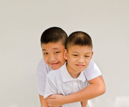 happy asian brother on white background Stock Photo