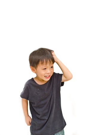 ittle asian boy thinking something on white background Stock Photo
