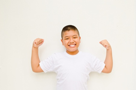 strong and happy asian boy on white background