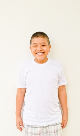 young asian boy smiling on white background photo