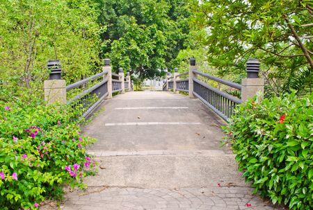 Old concrete bridge in park photo