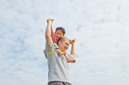 portrait of a happy dad with son
