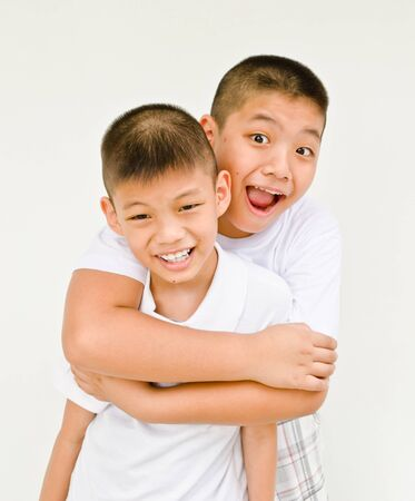 happy asian brother on white background photo