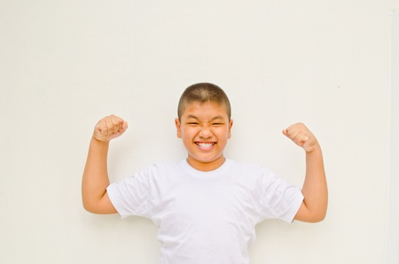 strong asian boy on white background Stock Photo