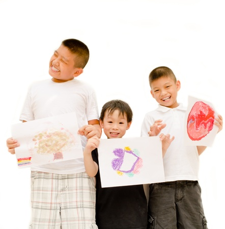 Three asian boys showing their drawing