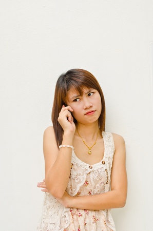 pretty asian girl waiting for talk with someone by cellphone