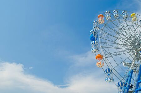 Brightly colored Ferris wheel against the blue sky photo