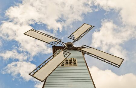 windmill over cloudy sky