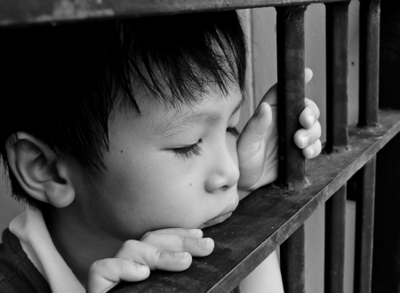Young Child Looking Sad  photo