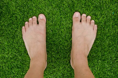 bare foot: Foot over green grass