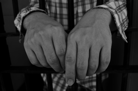 Hands of prisoner Stock Photo - 22916034